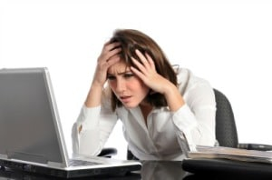 Woman looking frustrated and procrastinating